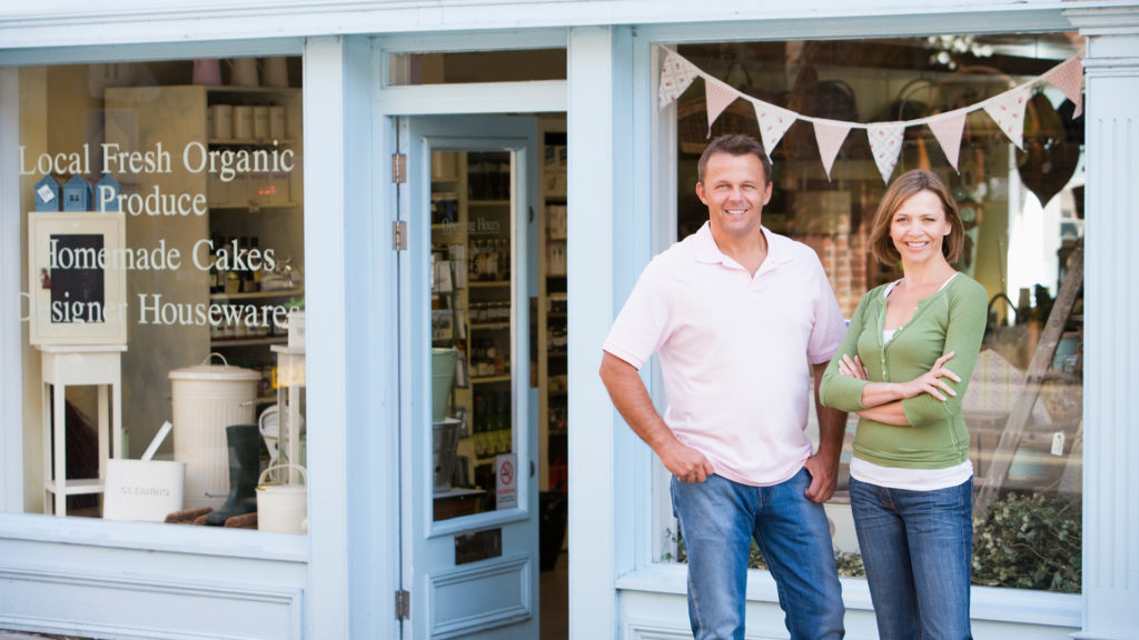 Business couple in front of organic store