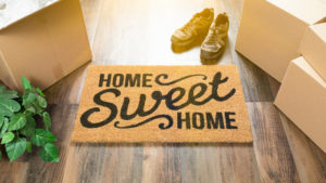 door mat with moving boxes
