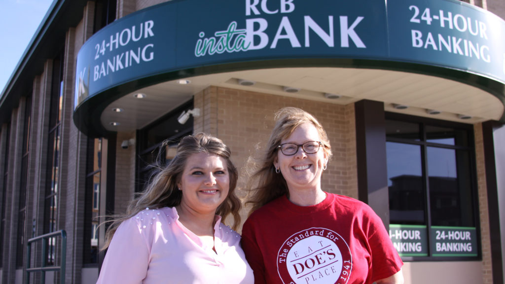 Two ladies in front of RCB Bank's ITM in Claremore