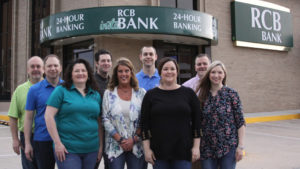 RCB Bank Staff standing in front of their new ITM
